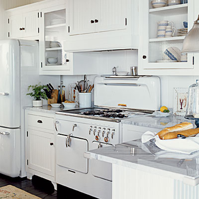 White-10-lInstall white beaded board and retro appliances to create classic cottage style in the kitchen. Oil-rubbed hardware provides dramatic contrast.